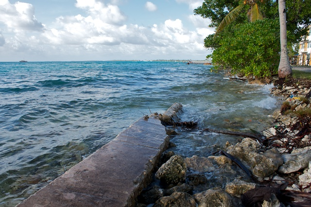 Waves washing over the seawall in Funafuti, Tuvalu