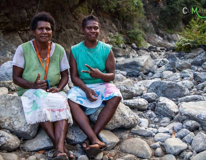 Espiritu Santo Island, Vanuatu. Lucy & Lewie sit in a dry creek bed , which only flows where there is heavy rain. The last rain they saw was in January 2016. Even so, these women are never short of smiles. ©Tessa Fox